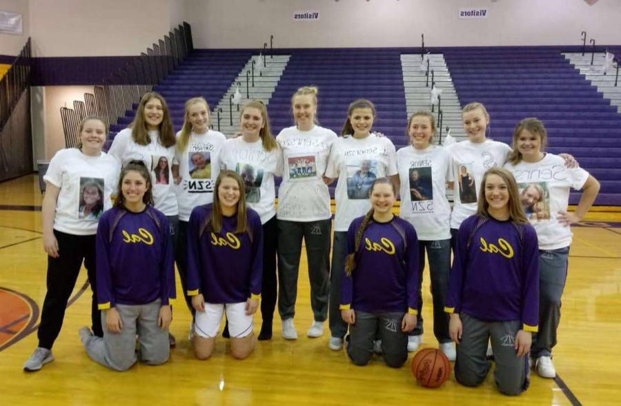 Madison and fellow seniors pose with underclassman teammates wearing personalized t-shirts of young photos.