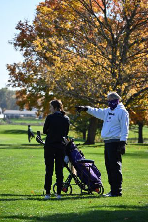 Coach Wagner coaches Natalie at the state finals. He offers some advice on her next shot.  Natalie shoots her next shot admirably.